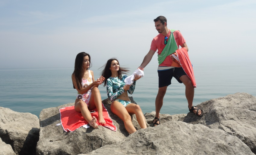 Dan wood dispenses Snappy Towels at Bluffers Beach photo shoot
