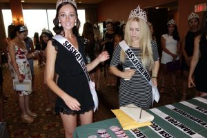 Miss Teen Saskatoon at registration table opening night